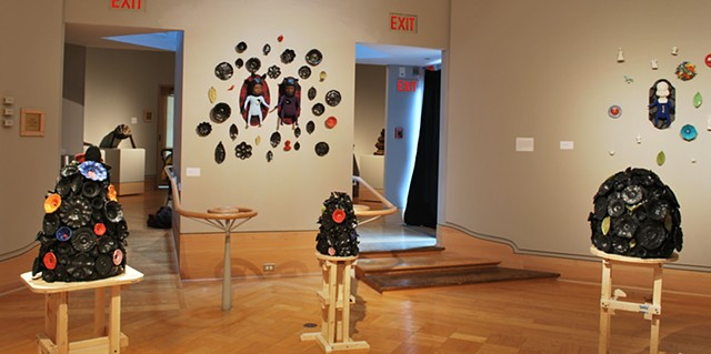 wall and floor pieces.  Ceramic flower forms on plywood pedestals.  Wall installations of porcelain flowers, doll figures with animal heads and open bodies, flower rounds and cast found objects