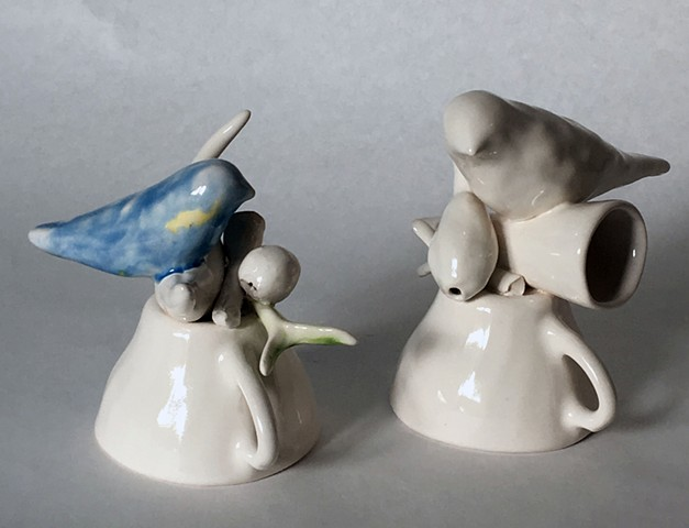 Cast porcelain cups with birds and branches