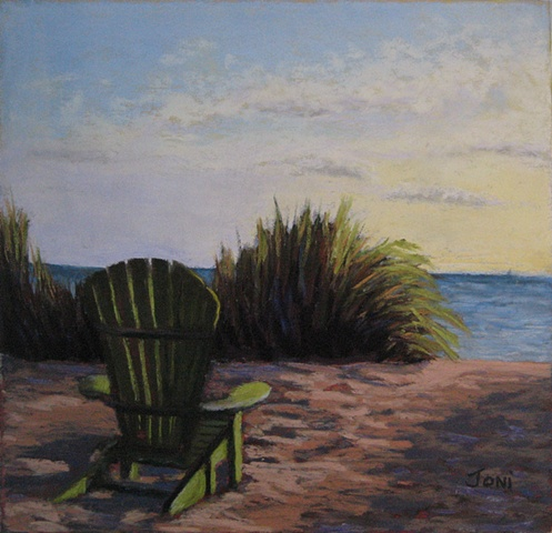 pastel painting of a green adirondack chair on the beach at sunset