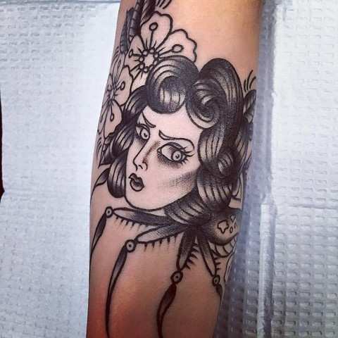 Black and Grey traditoinal Black Widow spider woman tattoo by Cassandra Knox