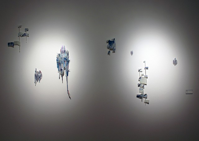 Shrink plastic, ink and collage installation.