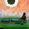 Guatemalan Woman w/Green Car