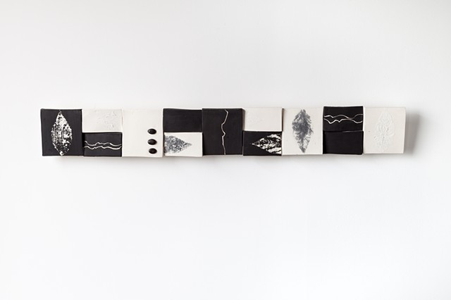 ceramic, clay, sculpture, wall hanging, terracotta, nature, natural, art, craft, black, white scroll by Carol Rissman