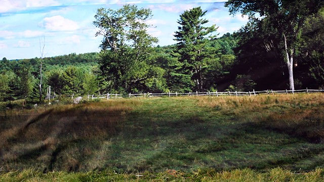 A Woman Runs Through A Pastoral Setting.