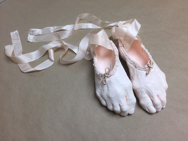 Sculpture of my feet as a pair of ballet slippers.