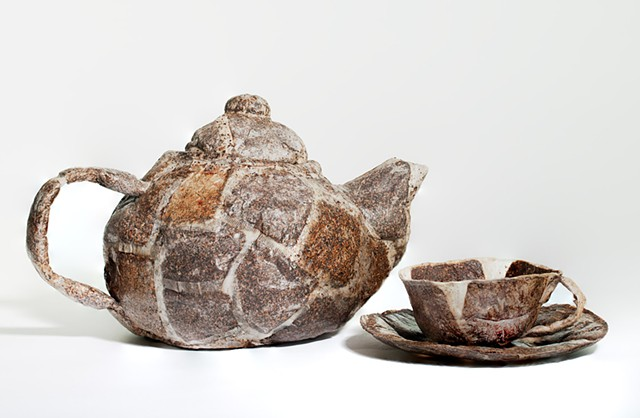 Sculpture/conceptual art object of a teapot, cup & saucer made of teabags & glue.