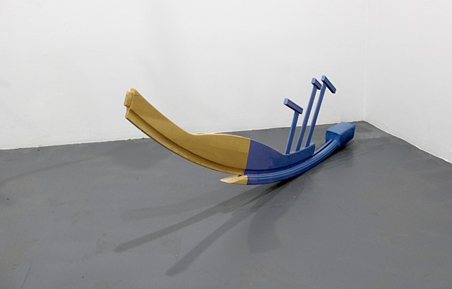 sculpture created with found furniture, paint, concrete; title is Parkland
