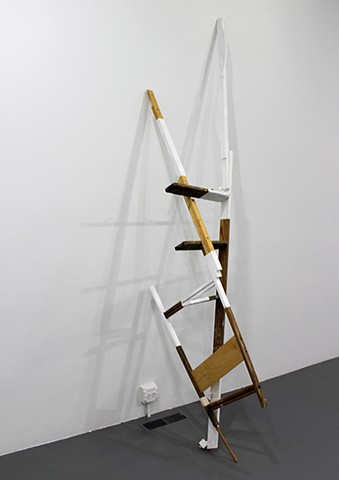 sculpture created with found ladder, paint, gesso, wood; title is Get Over It