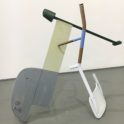sculpture created with found furniture, paint, plaster; title is Commencement