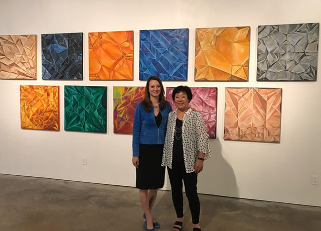 Left to right - Gallery owner Cindy Lisica and Artist Chun Hui Pak along with artist origami interpretations of Chinese Zodiac.