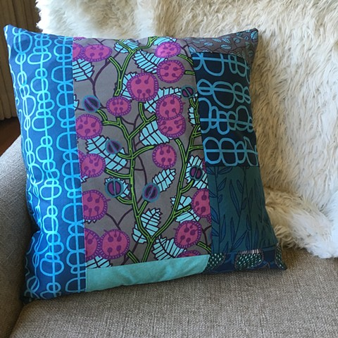 Quilted pillow case, featuring some of my seed pod fabric designs