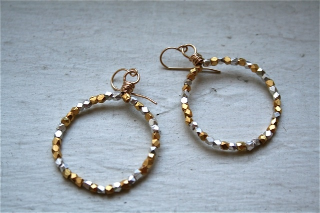 glam it up with these small gold hoops studded with sparkly silver and gold beads.