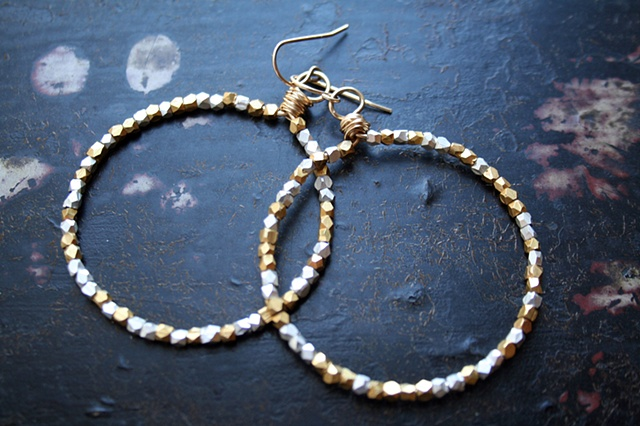 glam it up with these fabulous gold hoops, studded with sparkly silver and gold beads.