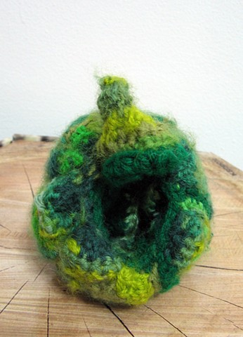 Crochet bell pepper green pepper toy yarn fiber art by Pat Ahern.