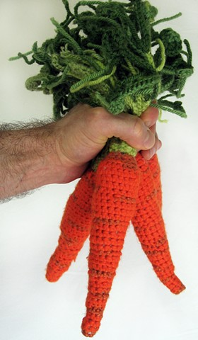 Crochet carrot vegetable yarn fiber art by Pat Ahern..