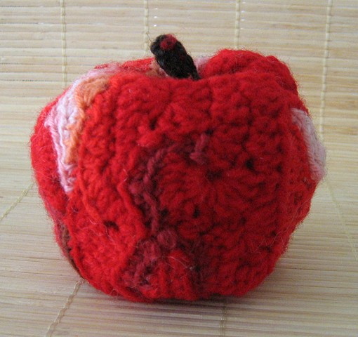 Crochet red apple yarn fiber art by Pat Ahern.