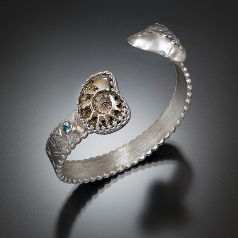 pyrite, ammonite, sterling silver, 14 kt. gold, blue topaz
