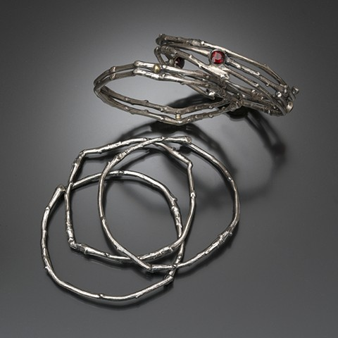 Collection of single, double, triple sterling silver apple branch bangles, sizes medium and large, red garnet, 18 karat gold