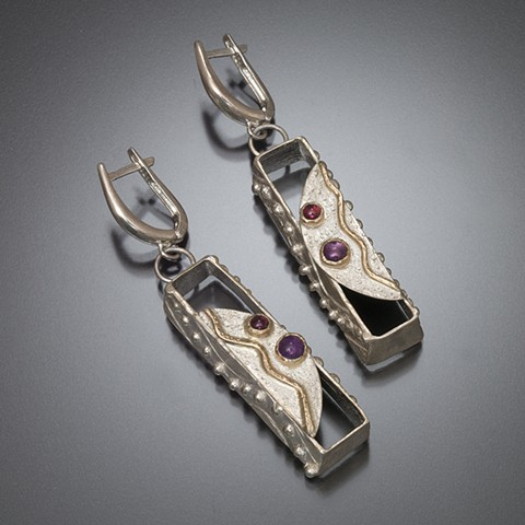 Carved and cast tapered silver sculptural boxes decorated with silver and gold overlays with garnet and amethyst