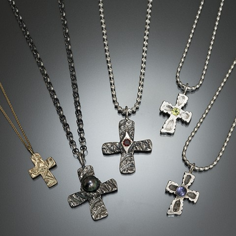 Lost-wax carved crosses in silver and gold with gems in blue, red, green, yellow, pearl