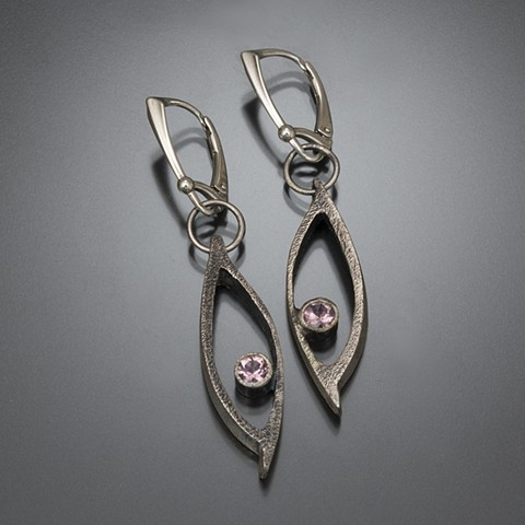 Open elliptical forms with pink tourmaline floating stone