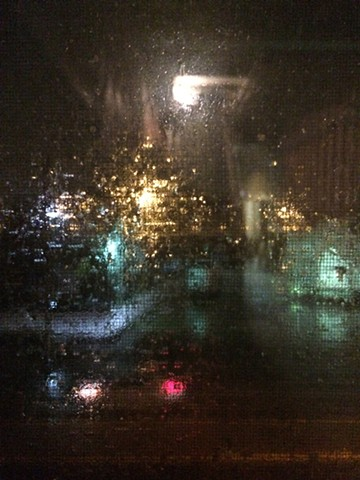 Through studio window, rainy night