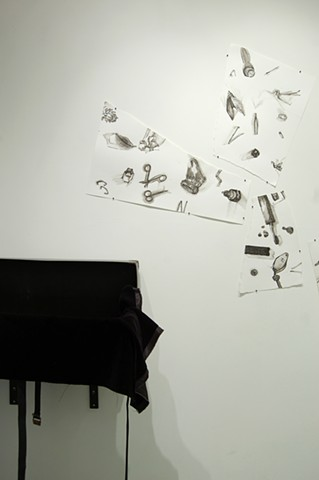 small objects; end of suitcase, beginning of drawings