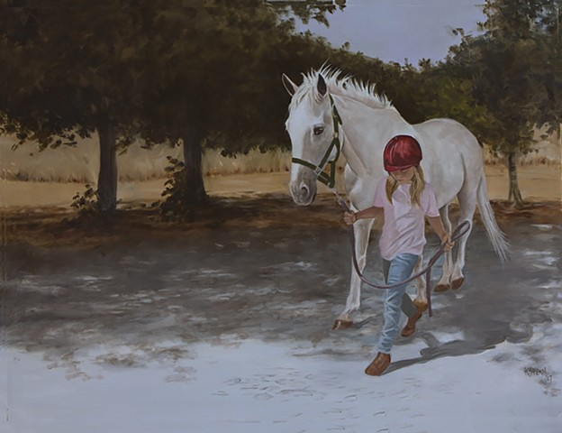 Young girl walking her grey mare.