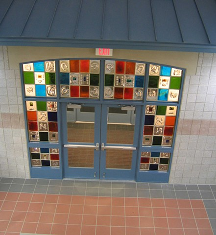 Lincolnville School Entry  Lincolnville, ME  Handmade cast glass blocks with embossed and embedded motifs