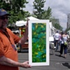 "Art Students League of Denver 2008 Summer Art Market with fellow artist, Tim McKay, holding ""Late Summer Pond"""