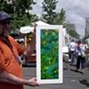 "Art Students League of Denver 2008 Summer Art Market with fellow artist, Tim McKay, holding ""Late Summer Pond"""