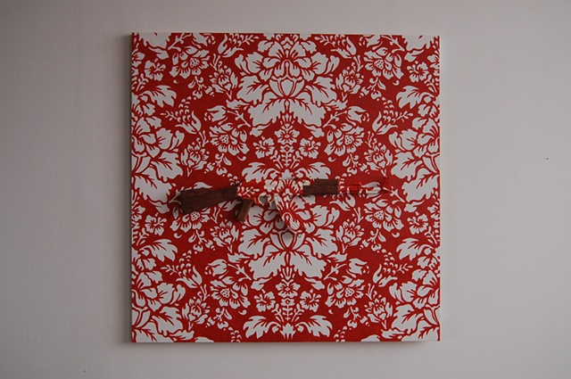artwork consisting of wood, paint, ceramic, underglaze, glaze. ceramic AK/47 victorian wallpaper pattern red & white.