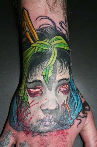 severed geisha head hand