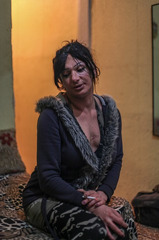 Glory, a Transgender prostitute, smokes a cigarette in her tiny dilapidated apartment near Taksim Square in Istanbul, Turkey.