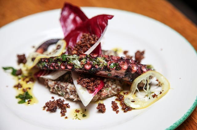Grilled Spanish Octopus with Ibérico Ham,  Pedrosillano Garbanzos, Pine Nuts,  Galette of Quinoa and Teff