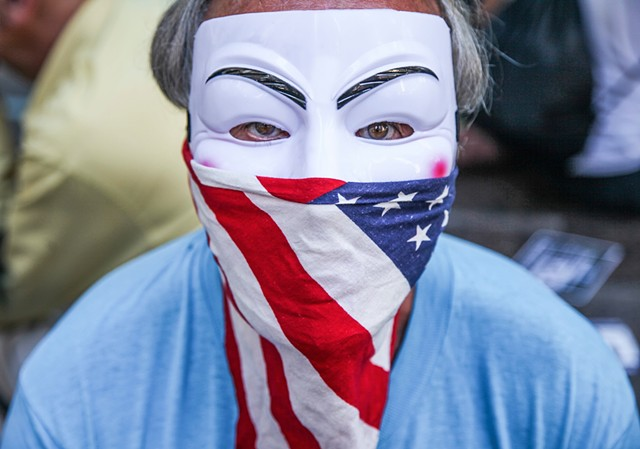 An activist rallies in Zuccotti Park on the anniversary of Occupy Wall Street on September 17, 2015.