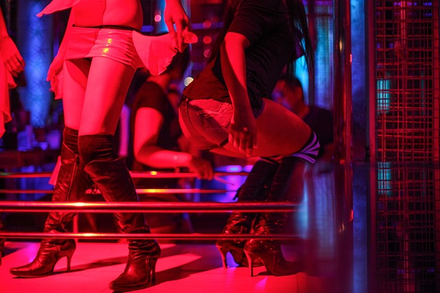 Exotic dancers perform at a strip club in Angeles, Philippines. Angeles, which was once home to Clark Air Base, is still a hotspot for prostitution and trafficking despite Mount Pinatubo's detrimental volcanic eruption in 1991, which closed the base.