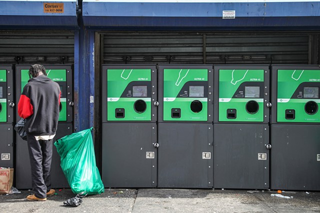 A homeless man deposits bottles at the Pathmark supermarket on 125th and Lexington Avenue on September 28, 2015.