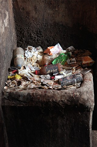 The overflowing trash bins in each hallway of the Rathkhola Brothel in Faridpur, Bangladesh hold used condoms, trash, and other hazardous materials, and are cleaned only once a week by the building's owner.