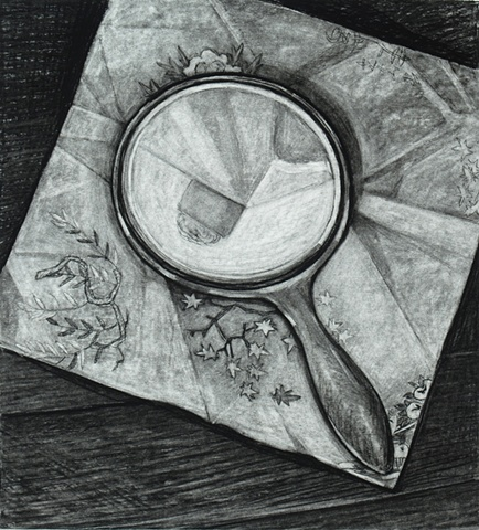 Hand Mirror on Japanese Paper on Wood Floor