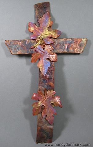 polymer clay grape leaves on copper wall cross by Nancy Denmark Ken Webb