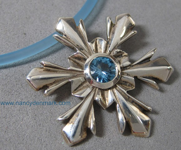 sterling silver snowflake pendant with blue topaz © Nancy Denmark