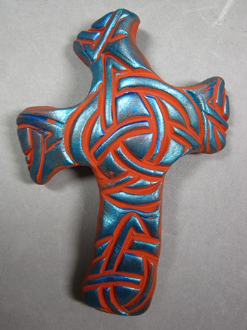 polymer clay hand cross made by Nancy Denmark with celtic knot design