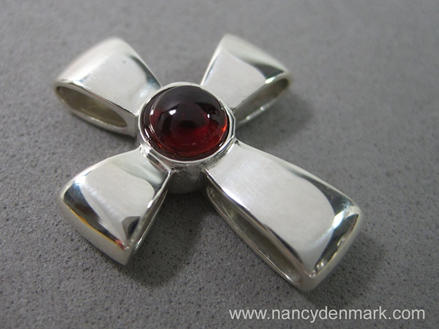 sterling silver cross with garnet by Nancy Denmark