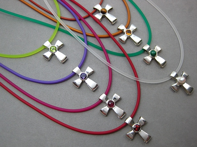 © Nancy Denmark gemstone ribbon crosses shown on colored cord necklaces