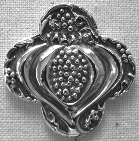 sterling silver quatrefoil pendant with pomegranate design by Nancy Denmark