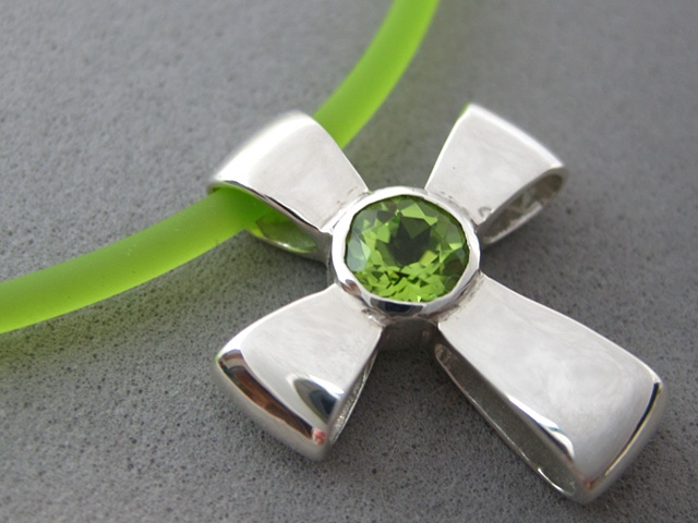 sterling silver ribbon cross with faceted peridot © Nancy Denmark