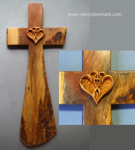 "Mesquite cross by Margaret Bailey with Nancy Denmark's ""One in the Spirit"" symbol"