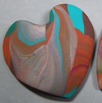"""handful of love"" polymer clay heart made by Nancy Denmark"