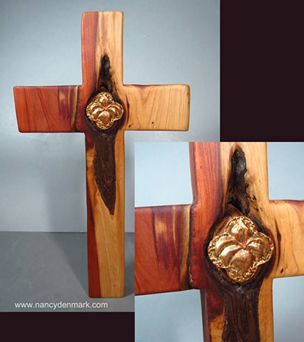 collaborative cedar cross by Margaret Bailey with Nancy Denmark's lily quatrefoil symbol
